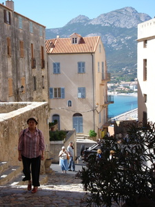 A travller is reaching the top of the citadel in Calvi