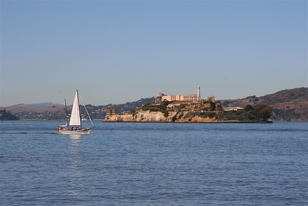Sail boat passing in front of Alcatraz