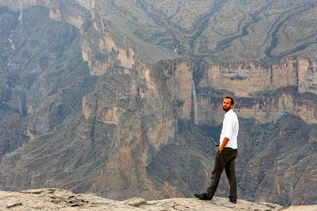 Kyrre in front of a waterfall on Jebel Shams